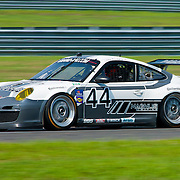 Driven by Stanton Potter Magnus Racing No. 44 Porsche GT3 speeds down the straightaway during qualifying Friday, July 22, 2011, at New Jersey Motorsports Park in Millville New Jersey.<br />