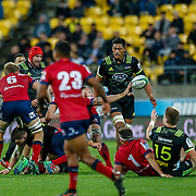 Scott Higginbotham (captain) passes during the Super rugby union game (Round 14) played between Hurricanes v Reds, on 18 May 2018, at Westpac Stadium, Wellington, New  Zealand.    Hurricanes won 38-34.