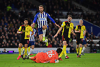 Football - 2019 / 2020 Premier League - Brighton & Hove Albion vs. Watford<br /> <br /> Watford's Ben Foster claims the ball from Brighton & Hove Albion's Glenn Murray, at the Amex Stadium.<br /> <br /> COLORSPORT/ASHLEY WESTERN