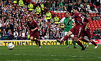 Paul Hartley takes the penalty and scores for his hat-trick and Hearts fourth goal of the day. Photo: Tom Ross.<br />