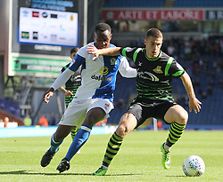 Ryan Nyambe of Blackburn Rovers (L) and Tommy Rowe of Doncaster Rovers in action - Mandatory by-line: Jack Phillips/JMP - 12/08/2017 - FOOTBALL - Ewood Park - Blackburn, England - Blackburn Rovers v Doncaster Rovers - English Football League One