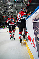 KELOWNA, CANADA - DECEMBER 6:  Rourke Chartier #14 and Tyrell Goulbourne #12 of Kelowna Rockets exit the ice against the Prince Albert Raiderson December 6, 2014 at Prospera Place in Kelowna, British Columbia, Canada.  (Photo by Marissa Baecker/Shoot the Breeze)  *** Local Caption *** Rourke Chartier; Tyrell Goulbourne;