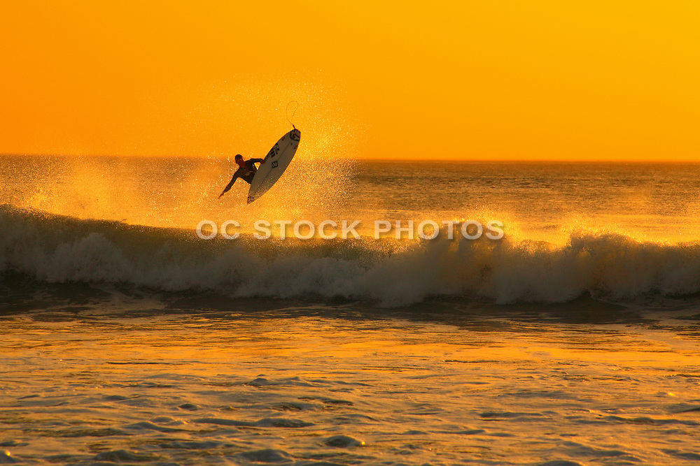 Surfer Catching Air While Surfing