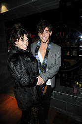 WILLA KESWICK and TOM GRAHAM at the Tatler Little Black Book Party held at Chinawhite, 4 Winsley Street, London on 20th November 2009.