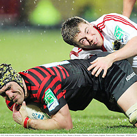 16 December 2012; Kelly Brown, Saracens, is tackled by Luke O'Dea, Munster. Heineken Cup 2012/13, Pool 1, Round 4, Saracens v Munster, XXX, London, England. Picture credit: Matt Impey / SPORTSFILE