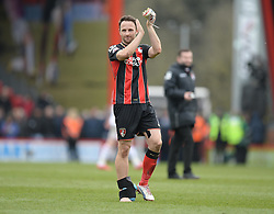 Bournemouth's Marc Pugh claps the home fans with a ice pack around his right ankle.  - Photo mandatory by-line: Alex James/JMP - Mobile: 07966 386802 - 21/03/2015 - SPORT - Football - Bouremouth - Goldsands Stadium - Bournemouth v Middlesbrough - Sky Bet Championship