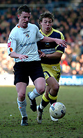 Photo: Ian Hebden.<br /> Luton Town v Derby County. Coca Cola Championship. 18/03/2006.<br /> Luton's Kevin Foley (L) beats Derby's Lee Holmes (L) to the ball.