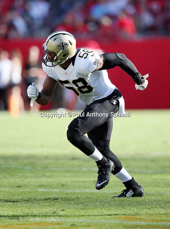 New Orleans Saints defensive end Obum Gwacham (58) chases the action during the 2015 week 14 regular season NFL football game against the Tampa Bay Buccaneers on Sunday, Dec. 13, 2015 in Tampa, Fla. The Saints won the game 24-17. (©Paul Anthony Spinelli)