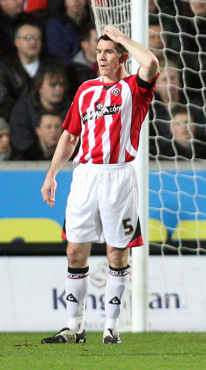 Hull - Thursday February 26th, 2009:  Chris Morgan of Sheffield United after scoring his own goal during the FA Cup fifth round match replay at K.C Stadium, Hull. (Pic by Darren Walker/Focus Images)