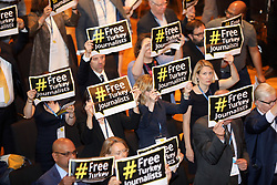 May 18, 2017 - Hamburg, Germany - GRIT CROSS, editor at ZDF, joins fellow journalists, including in front row left, DAVAN MAHARAJ, Editor-in-Chief and Publisher of the Los Angeles Times, showing solidarity for Turkish journalist being imprisoned without due process, by holding up signs with message: # FREE Turkey Journalists at the Town Hall Meeting: Building The Journalism WE Need, where hundreds of top editors from all over the globe gathered for IPI (International Press Institute) 2017 World Congress. (Credit Image: ? Scott Mc Kiernan/ZUMA Wire)