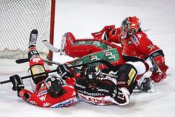 28.12.2013, OlympiaWorld Arena, Innsbruck, AUT, EBEL, HC TWK Innsbruck vs HC Orli Znojmo, 60th Game Day, in picture Zdenek Blatny (HC Orli Znojmo, #13) and Justin Donati (HC TWK Innsbruck, #81) crashes in to goalkeeper Adam Munro (HC TWK Innsbruck, #51) during the Erste Bank Icehockey League 60th Game Day match between HC TWK Innsbruck and HC Orli Znojmo at the OlympiaWorld Arena, Innsbruck, Austria on 2013/12/28. (Photo By Matic Klansek Velej / Sportida)