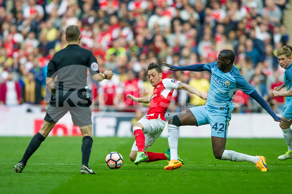 Mesut Ozil of Arsenal and Yaya Touré of Manchester City during the The FA Cup Semi Final match between Arsenal and Manchester City at Wembley Stadium, London, England on 23 April 2017. Photo by Salvio Calabrese.