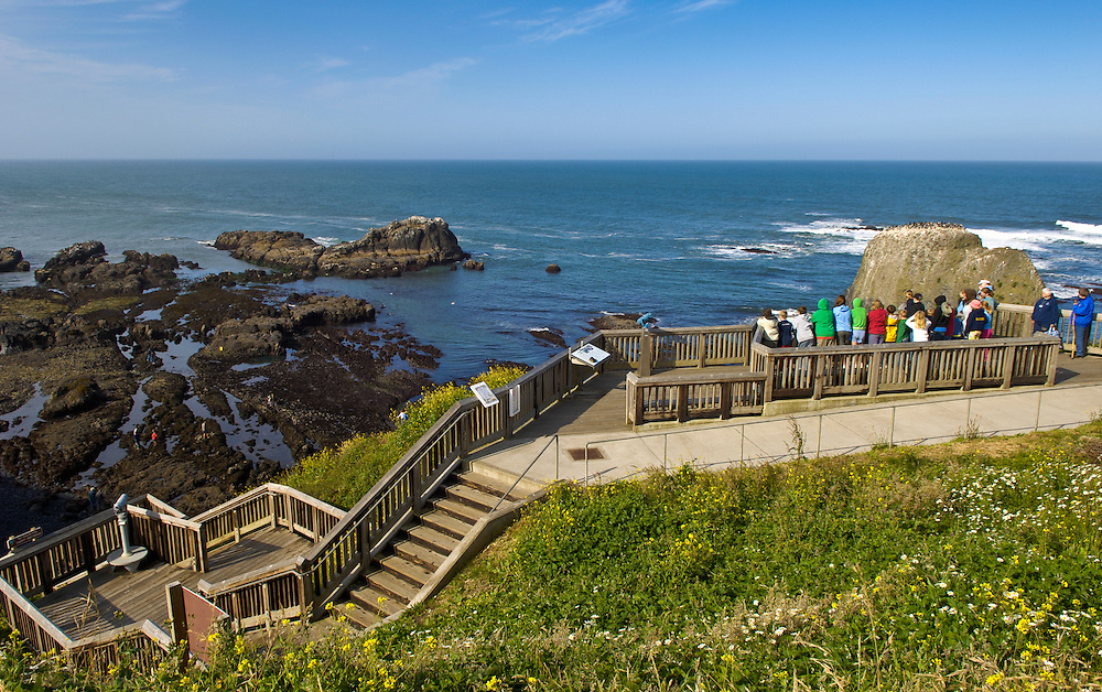 School group at viewpoint overlooking tidepools at Yaquina Head Outstanding Natural Area on the central Oregon coast.