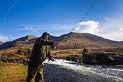 Salmon angler on the Bundorragha  river, not far from Delphy Lodge, a Georgian Country House celebrated worldwide by salmon anglers. Georgian Country House celebrated worldwide by salmon anglers.