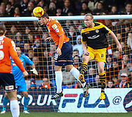 Luke Wilkinson of Luton Town clears the ball under pressure from Lee Minshull of Newport County (right) during the Sky Bet League 2 match at Kenilworth Road, Luton<br /> Picture by David Horn/Focus Images Ltd +44 7545 970036<br /> 20/12/2014