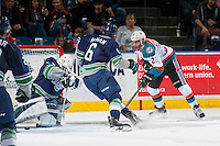 KELOWNA, CANADA - FEBRUARY 13: Devante Stephens #21 of the Kelowna Rockets passes the puck in front of the net of Matt Berlin #29 of the Seattle Thunderbirds on February 13, 2017 at Prospera Place in Kelowna, British Columbia, Canada.  (Photo by Marissa Baecker/Shoot the Breeze)  *** Local Caption ***