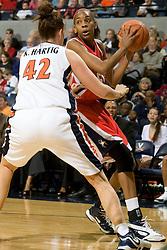 Richmond forward/center Crystal Goring (55) is guarded along the baseline by Virginia forward Kelly Hartig (42).  The Virginia Cavaliers women's basketball team faced the Richmond Spiders at the John Paul Jones Arena in Charlottesville, VA on November 18, 2007.