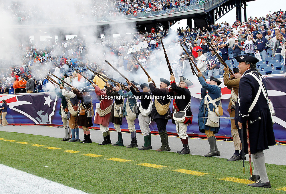 Minutemen fire their muskets after the New England Patriots NFL regular season week 3 football game against the Buffalo Bills on September 26, 2010 in Foxborough, Massachusetts. The Patriots won the game 38-30. (©Paul Anthony Spinelli)