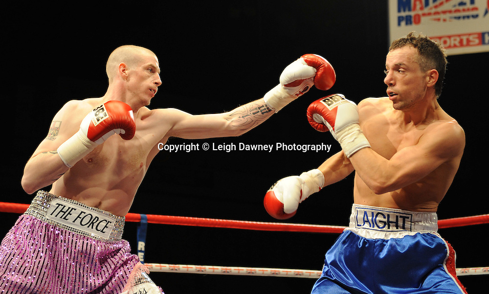 James Flinn (pink shorts) defeats Kristian Laight at Coventry Skydome, Coventry, United Kingdom on 23rd April 2010. Frank Maloney Promotions.Photo credit: © Leigh Dawney