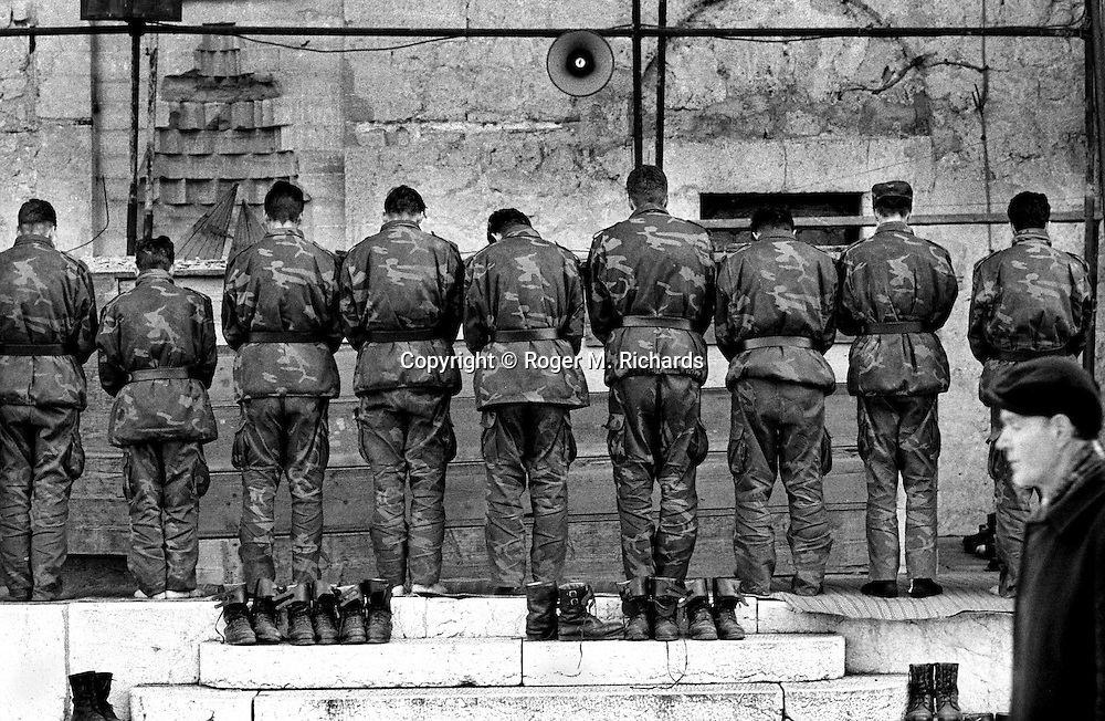 Bosnian soldiers pray at the Begova Mosque during the final days of the siege of the city, Sarajevo, Bosnia and Herzegovina, January 1996. PHOTO BY ROGER RICHARDS