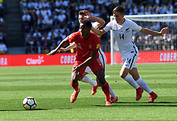 Peru's Andre Carrillo, left, under pressure from New Zealand's Ryan Thomas in the Soccer World Cup qualifying match, Westpac Stadium, Wellington, New Zealand, Saturday, November 11, 2017. Credit:SNPA / Ross Setford  **NO ARCHIVING**