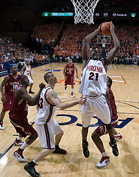 Virginia Cavaliers center Tunji Soroye (21) grabs an offensive rebound against FSU.  The Virginia Cavaliers Men's Basketball Team defeated the Florida State Seminoles 73-70 at the John Paul Jones Arena in Charlottesville, VA on February 17, 2007.