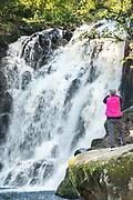 A tourist views the upper Cascada de Texolo waterfall near Xico, Veracruz, Mexico. The remote jungle area was used in filming the movie Romancing the Stone.