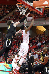 14 February 2015:   Evan Wessel reaches over Deontae Hawkins as they both chase down a missed shot during an NCAA MVC (Missouri Valley Conference) men's basketball game between the Wichita State Shockers and the Illinois State Redbirds at Redbird Arena in Normal Illinois