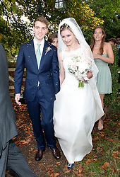 © London News Pictures. 14/09/2013.  The bride and groom leaving the church after the wedding. The wedding of Euan Blair, Son of former British Prime Minister Tony Blair,  to Suzanne Ashman at All Saints Parish Church in Wotton Underwood, Buckinghamshire. The wedding was attended by Former British Prime minister Tony Blair and his wife Cherie Blair. Photo credit: Ben Cawthra/LNP