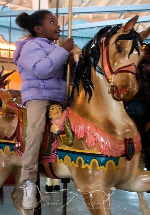 Alisha Lockhart, 6, rides the Dentzel Carousel Jan. 15, 2011 in Meridian, Miss. The carousel, which was built in 1896, is hand-carved and painted and is listed on the National Register of Historic Places. It is one of only 11 carousels nationwide to be named a National Landmark, and it is located in the only carousel building that remains from Dentzel's original blueprint. The carousel is open on Saturdays from 1 p.m. to 5 p.m. through March. Rides are 50 cents per person. (Photo by Carmen K. Sisson/Cloudybright)