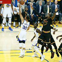 12 June 2017: Golden State Warriors guard Stephen Curry (30) goes for the layup past Cleveland Cavaliers forward LeBron James (23) during the Golden State Warriors 129-120 victory over the Cleveland Cavaliers, in game 5 of the 2017 NBA Finals, at the Oracle Arena, Oakland, California, USA.