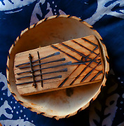 The Mbira is a West African musical instrument played by holding the instrument in the hands and plucking the tines with the thumbs.