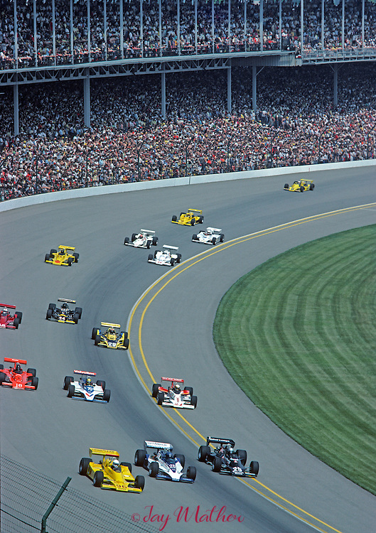Cars going through turn 1 at the start of the 1980 Indianpolis 500.