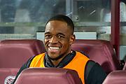 Uche Ikpeazu (#19) of Heart of Midlothian FC on the bench before the Ladbrokes Scottish Premiership match between Heart of Midlothian FC and Livingston FC at Tynecastle Park, Edinburgh, Scotland on 4 December 2019.