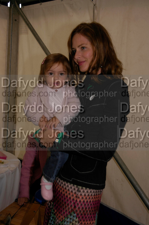 Trinny Woodall. Macmillan Dog Day in aid of Macmillan Cancer Relief. Royal Hospital Chelsea, 5 July 2005. ONE TIME USE ONLY - DO NOT ARCHIVE  © Copyright Photograph by Dafydd Jones 66 Stockwell Park Rd. London SW9 0DA Tel 020 7733 0108 www.dafjones.com