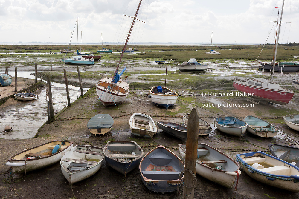 A landscape of assorted boats and estuary vessels at low-tide at Leigh creek in Old Leigh, on 10th September 2019, in Leigh-on-Sea, Essex, England.