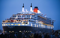 © Licensed to London News Pictures. 09/05/2014. Southampton, UK. Passengers on the stern of the Queen Mary 2. Firework celebrations marking the 10-year anniversary of the Cunard flagship, Queen Mary 2, take place in the port of Southampton this evening, 9th May 2014. All 'three queens' of the Cunard fleet were present at the event, which included a 10-minute firework display, one minute for every year that the QM2 has been in service. Photo credit : Rob Arnold/LNP
