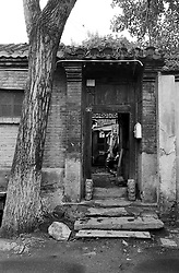Ornate traditional architecture of doorway to an old courtyard house in a Beijing hutong