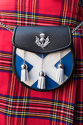 Close up of traditional Scottish tartan kilt and sporran