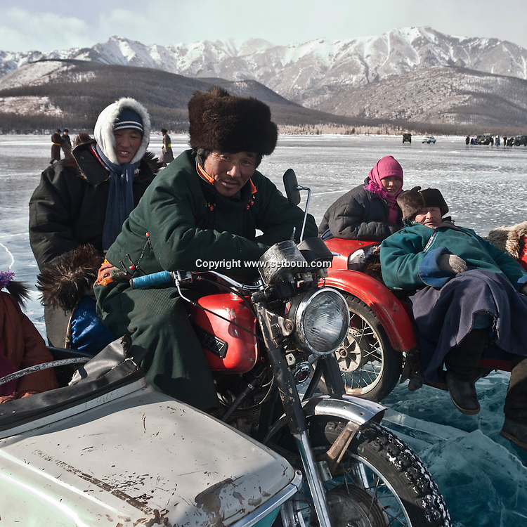 Mongolia. moto with side car.  the Hovsgol lake is frozen in winter   -