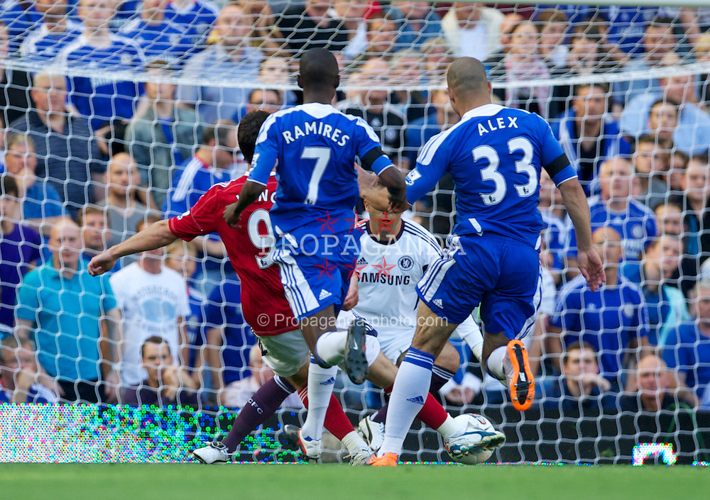 LONDON, ENGLAND - Saturday, August 20, 2011: West Bromwich Albion's Shane Long scores the first goal against Chelsea during the Premiership match at Stamford Bridge. (Pic by David Rawcliffe/Propaganda)