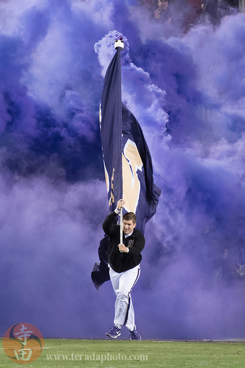 December 2, 2016; Santa Clara, CA, USA; Washington Huskies male cheerleader carries a team flag before the Pac-12 championship against the Colorado Buffaloes at Levi's Stadium. The Huskies defeated the Buffaloes 41-10.