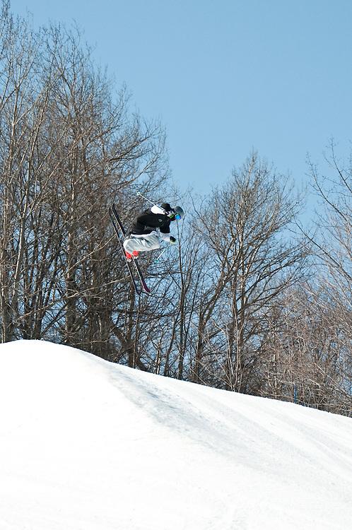 Skiers and snowboarders at Marquette Mountain ski area in Marquette Michigan.