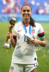 USA's Alex Morgan celebrates with the FIFA Women's World Cup Trophy and adidas Silver Boot award after the final whistle
