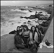 Girls posing near the sea. Street scenes in Rethymnon, western Crete. Autumn 2011. © Romano P. Riedo