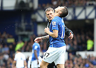 Muhamed Besic of Everton leaves the field after getting injured during the Barclays Premier League match against Chelsea, at Goodison Park, Liverpool.<br /> Picture by Michael Sedgwick/Focus Images Ltd +44 7900 363072<br /> 12/09/2015