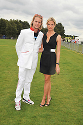 SAM BRANSON and ISABELLA ANSTRUTHER-GOUGH-CALTHORPE at the 25th annual Cartier International Polo held at Guards Polo Club, Great Windsor Park, Berkshire on 26th July 2009.