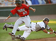 TinCaps shortstop Cole Figueroa (29) gets by Bees catcher Juan Graterol (41) to score the TinCaps' first run of the game in the second inning of game three of the Midwest League Championship at Community Field in Burlington, Iowa on September 17, 2009.