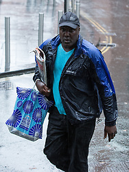 "© Licensed to London News Pictures . 23/10/2013 . Manchester , UK . AKINWALE AROBIEKE (aka PURPLE AKI ) arrives at Manchester Crown Court this morning (23rd October 2013) . Having been cleared of breaching a ban on touching men's muscles he now faces charges related to police harassment , namely he is alleged to have left Detective Sergeant Lewis Hughes ""to fear that violence would be used against him"" following an incident in Birmingham Town Hall on 7th October 2012 . Photo credit : Joel Goodman/LNP"