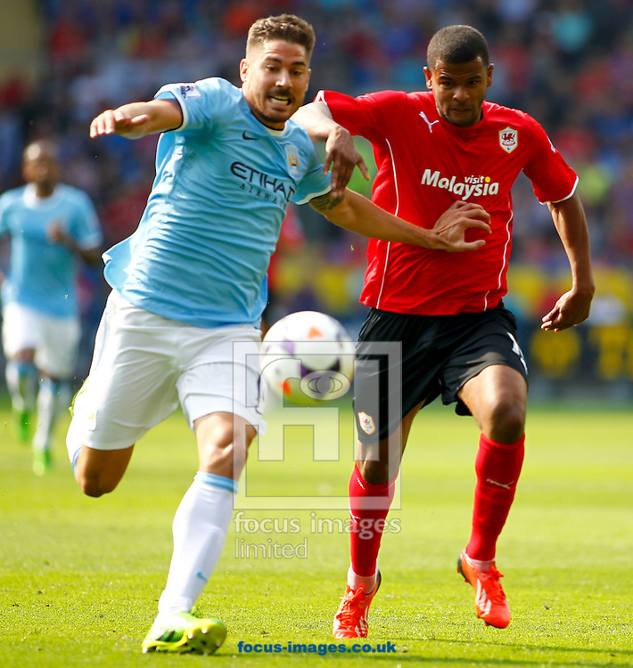 Picture by Mike  Griffiths/Focus Images Ltd +44 7766 223933<br /> 25/08/2013<br /> Fraizer Campbell of Cardiff City and Pablo Zabaleta of Manchester City during the Barclays Premier League match at the Cardiff City Stadium, Cardiff.